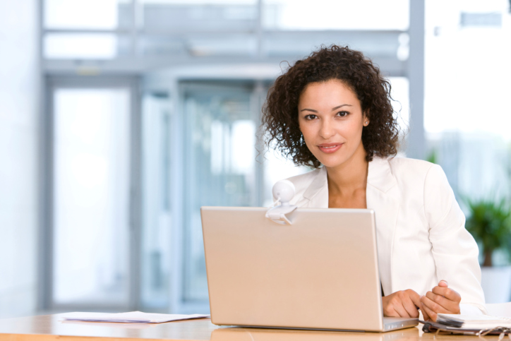 Smiling Woman With Laptop.