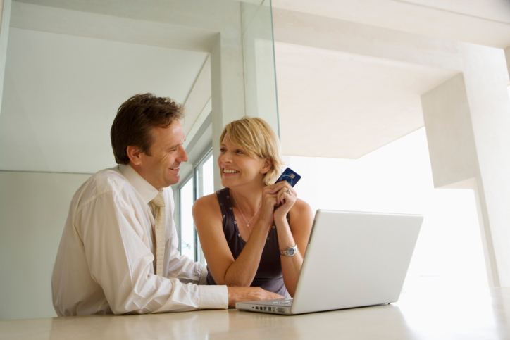 Couple Using Laptop, Holding Credit Card