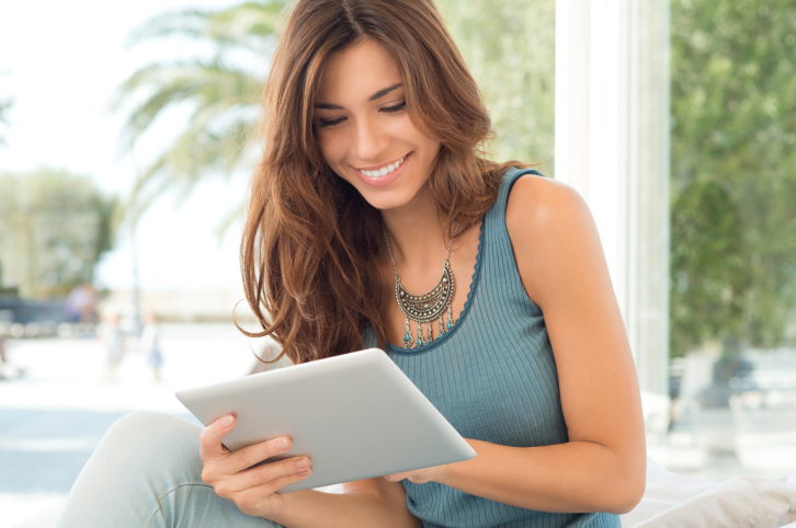 Smiling Woman With Digital Tablet.